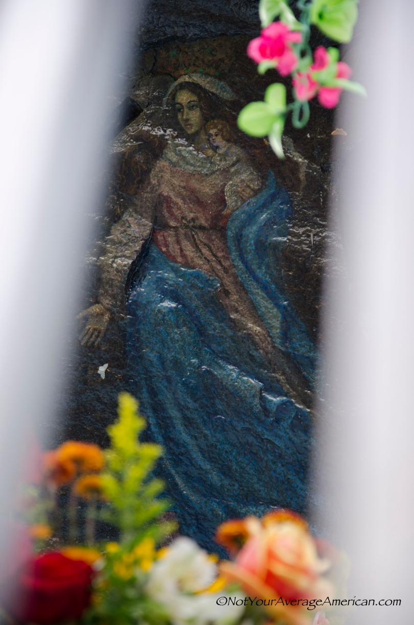 The Virgin of Alambi - hand painted on a rock wall deep in the Andean mountains.