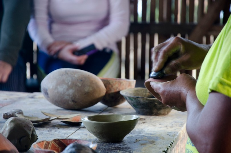 Burnishing a fired pot with a river stone.