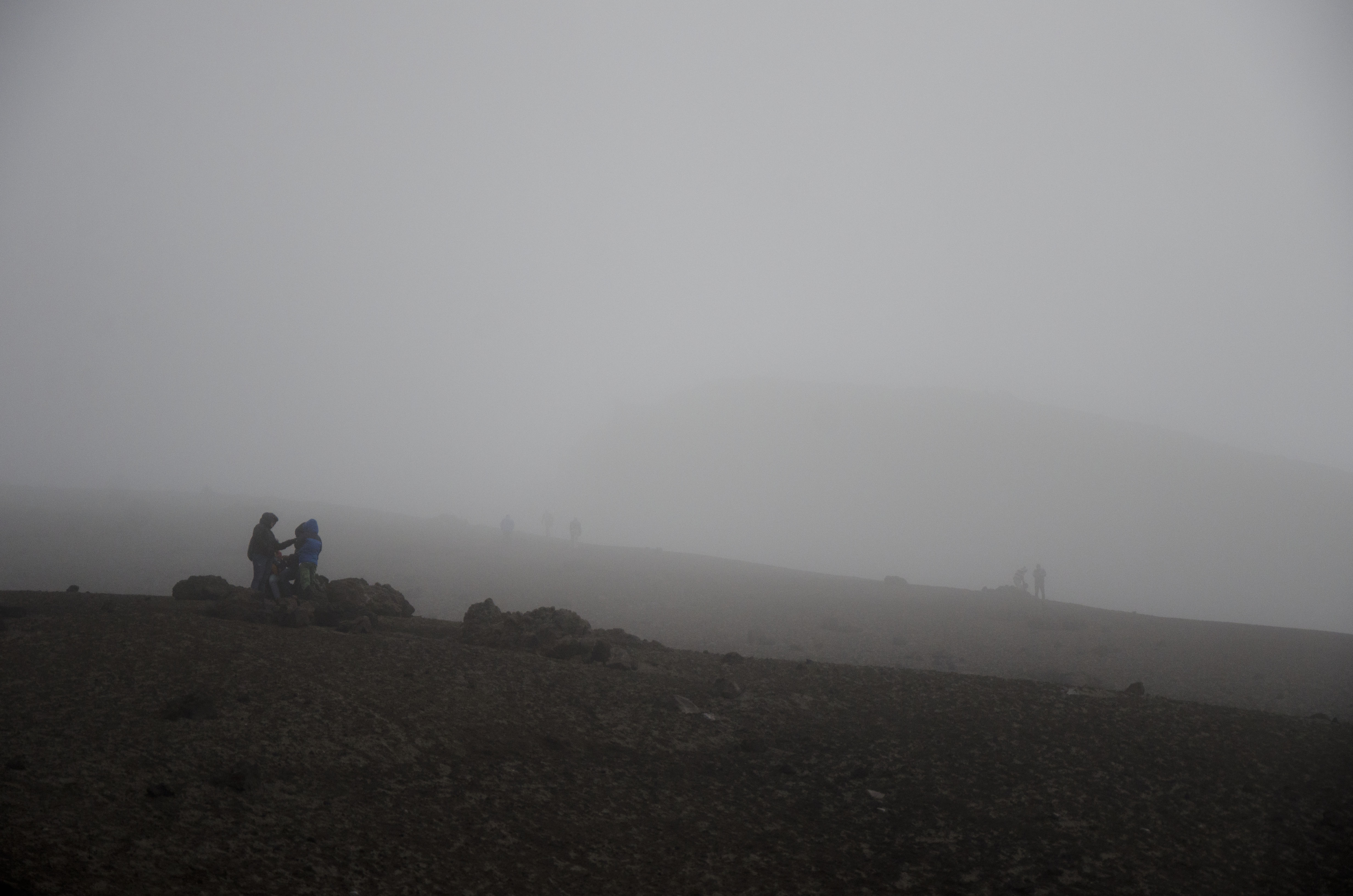 Layers and layers of clouds prevent us from seeing the top of Cotopaxi. Yet people are still choosing to hike to the Refugio.