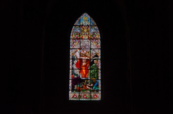 The stained glass windows are all very ornate.