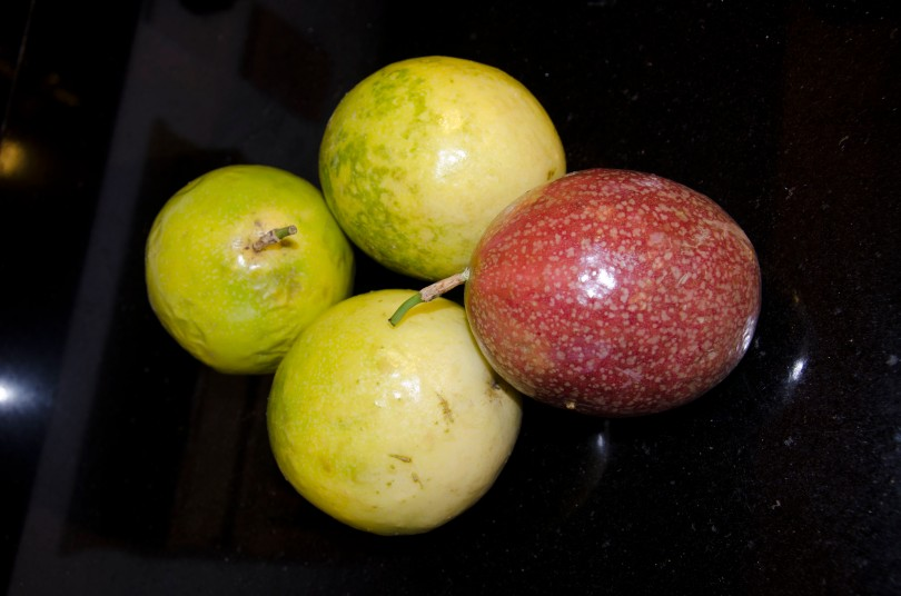 Whole Passion Fruit or Maracuya. Yellow is the more common variety. Both types look exactly the same inside.