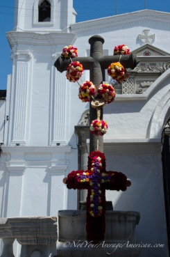 The morning light on the roses adorning the cross in front of El Convento del Carmen Alto.