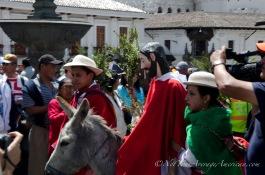 Joseph leading Jesus on a donkey.