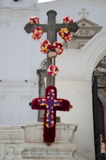 The rose draped cross in the afternoon light in front of the Convento del Carmen Alto.