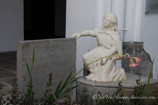 A small statue in the inner courtyard.