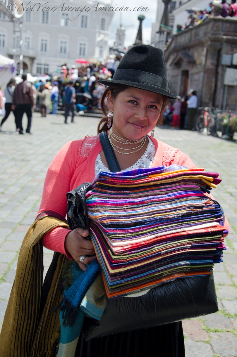 This young lady is Marta and she sells colorful scarves at the Plaza San Francisco, Quito, Ecuador.