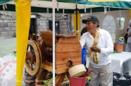 Making fresh squeezed cane juice - add a dash of lime and it's a very refreshing drink!