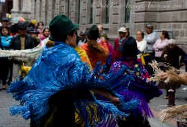 Colorful shawls sway in the movement of the dance.