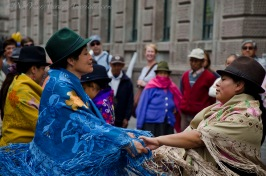 Joy and happiness while dancing for tourists in Quito.