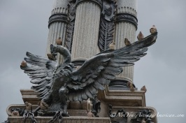 Pigeons roosting on the Condor in the Plaza de la Independencia.