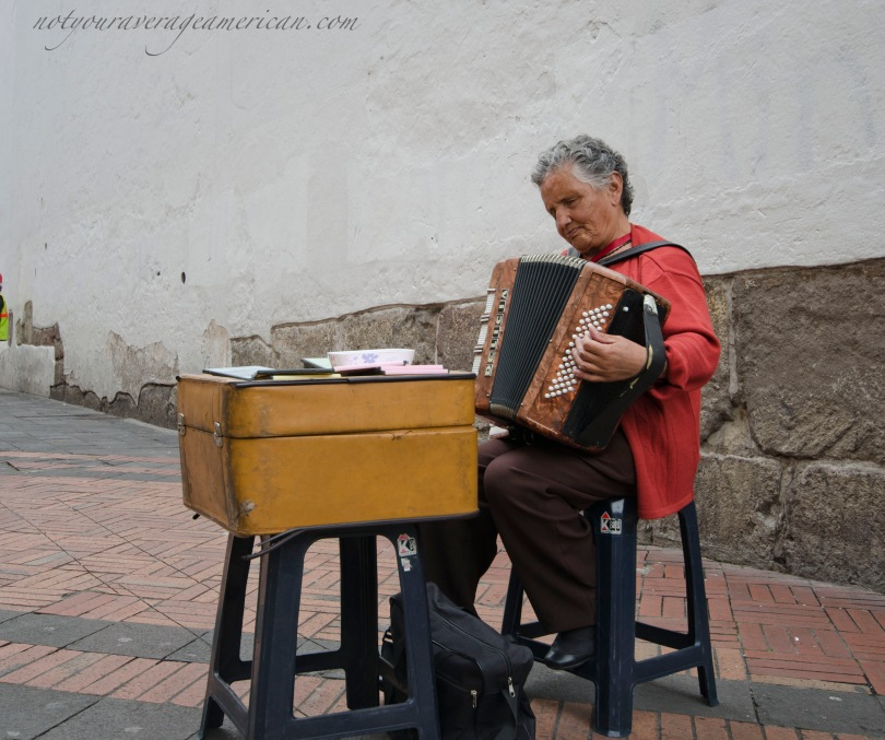 An accordion player in the Historic Center of Quito.