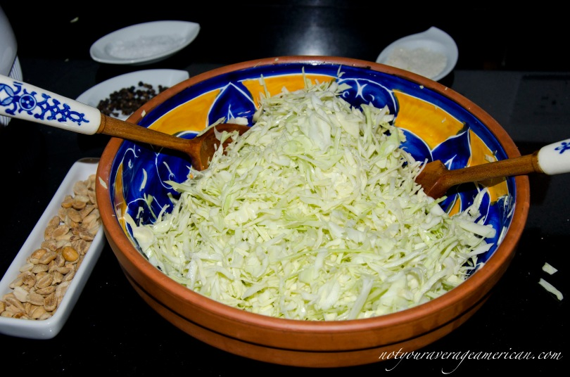 Toss the sugar, salt, and lime juice with the shredded cabbage.
