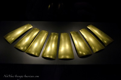 A necklace of polished gold.
