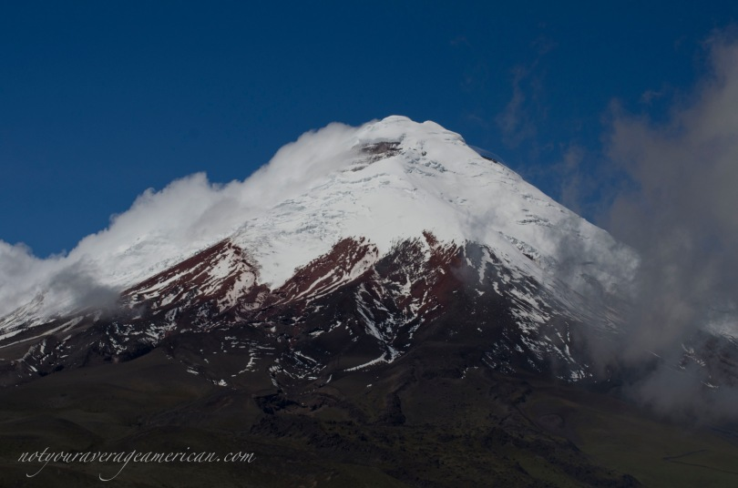 Volcano Cotopaxi on a clear morning. Locals have told me that summer has officially arrived because the winds have started and make it easier to see the many volcanoes that surround Quito.