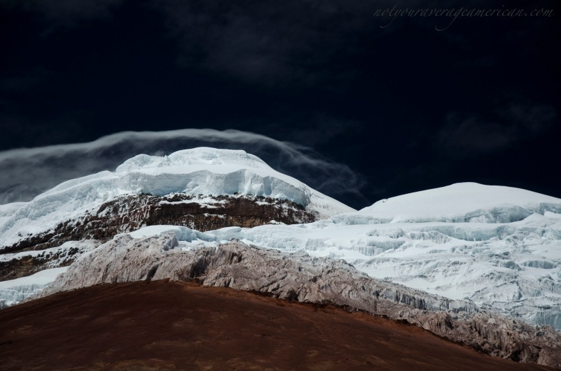 Last Saturday was literally the most beautiful day of the year to see Cotopaxi up close and personal. Mid-morning, the winds were flirting with the mountain top and the clouds that would later shroud the mountain were giving warning of things to come.